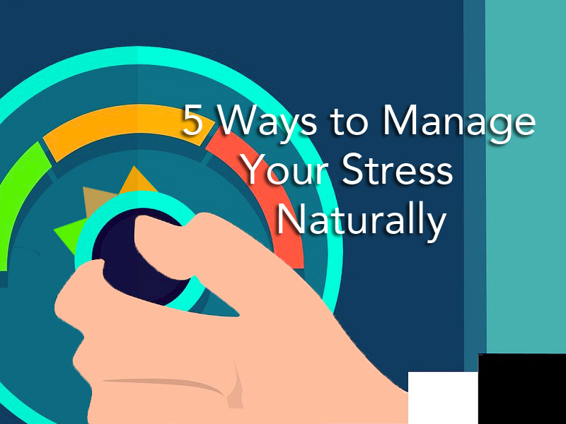 hand turning dial down to illustrate manage your stress naturally